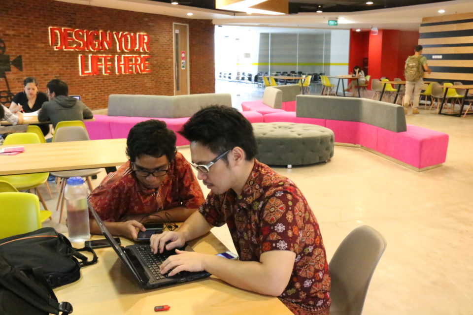 Falih and Christian on their project preparation